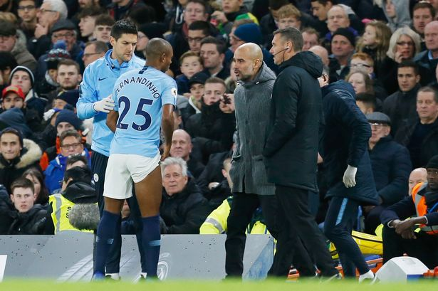 Fernandhinho getting assessed by Pep Guardiola. Image: Getty Images
