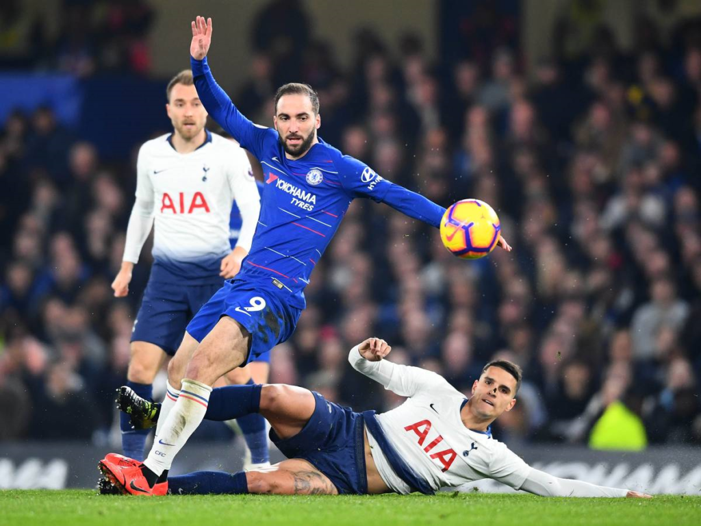 Gonzalo Higuain is challenged by Erik Lamela during the Premier League match at Stamford Bridge. Image: Getty Images